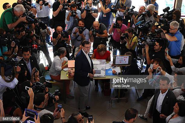 Mariano Rajoy Spain's acting Prime Minister of the caretaker government casts his vote for the Spanish general election on June 26 2016 in Madrid...