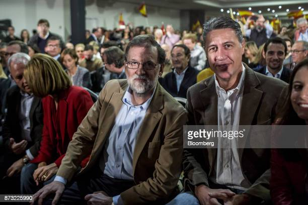 Mariano Rajoy Spain's prime minister and leader of the People's Party center sits in the audience next to Xavier García Albiol leader of the People's...
