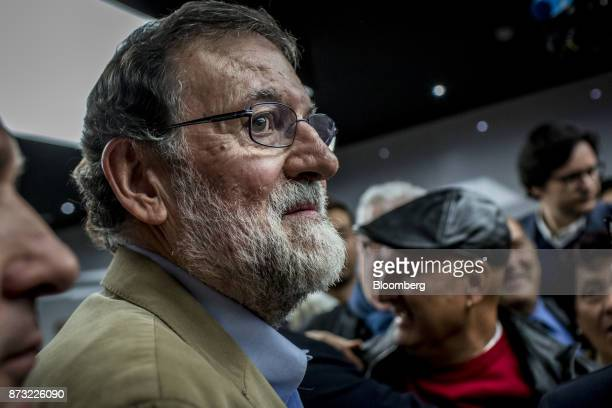 Mariano Rajoy Spain's prime minister and leader of the People's Party listens during an election campaign event in Barcelona Spain on Sunday Nov 12...