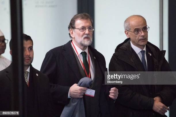 Mariano Rajoy Spain's prime minister center arrives at the One Planet Summit in Paris France on Tuesday Dec 12 2017 French President Emmanuel Macron...