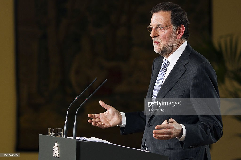 Mariano Rajoy, Spain's prime minister, gestures during a news conference at Moncloa palace in Madrid, Spain, on Friday, Dec. 28, 2012. Rajoy said 2013 will be 'very tough' amid the sixth year of an economic slump. Photographer: Angel Navarrete/Bloomberg via Getty Images