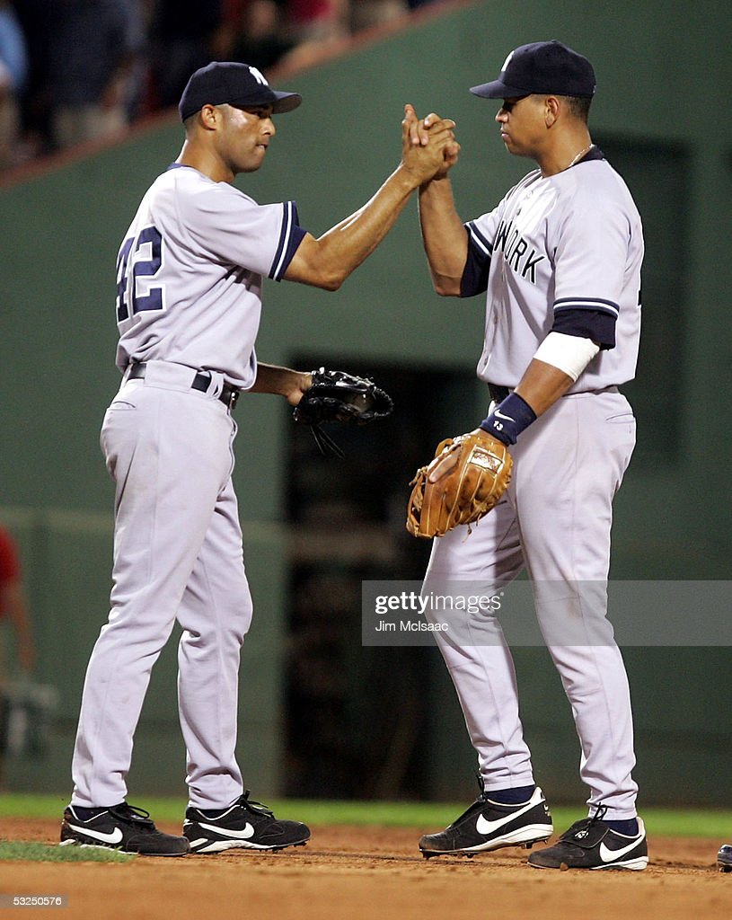Mariano Rivera #42 and Alex Rodriguez #13 of the New York Yankees celebrate their victory against the Boston Red Sox at Fenway Park on July 17, 2005 in Boston, Massachusetts.The Yankees defeated the Red Sox 5-3.