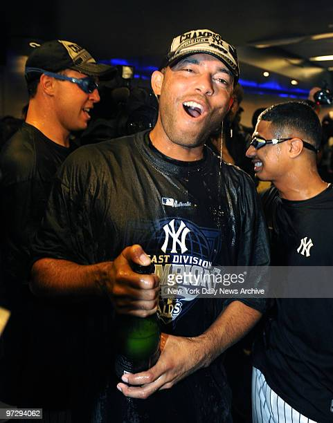 Mariano Rivera celebrates his 11th divison title with Yankees at the club house after the Yankees defeated the Red Sox 42 winning the American League...