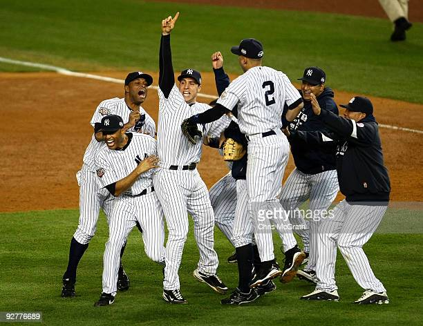 Mariano Rivera Damaso Marte Mark Teixeira and Derek Jeter of the New York Yankees celebrate with teammates after their 73 win against the...