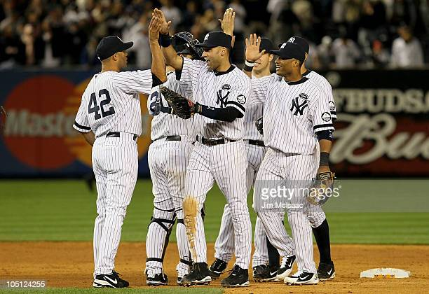 Mariano Rivera Derek Jeter and Robinson Cano of the New York Yankees celebrate after their 61 win against the Minnesota Twins during Game Three of...