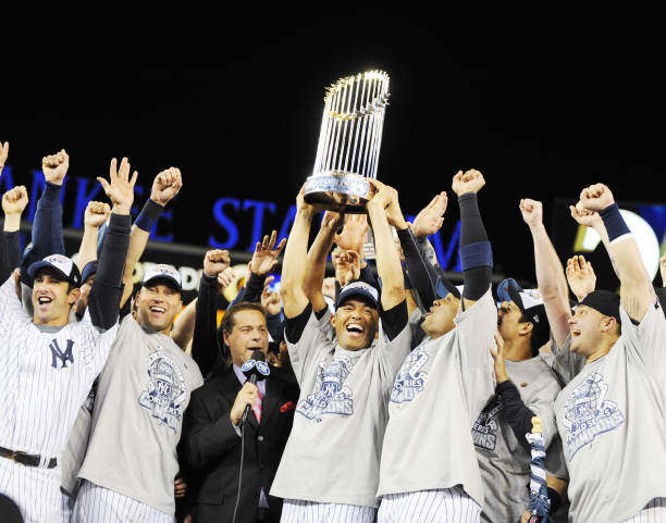 Mariano Rivera holds trophy as New York Yankees celebrate on