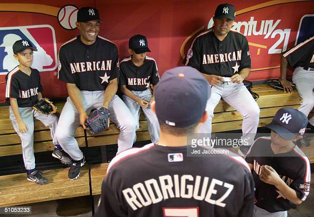 Mariano Rivera of the American League and sons Mariano Jr and Jafez joke with coach Luis Sojo and Ivan Rodrigues before the Major League Baseball...