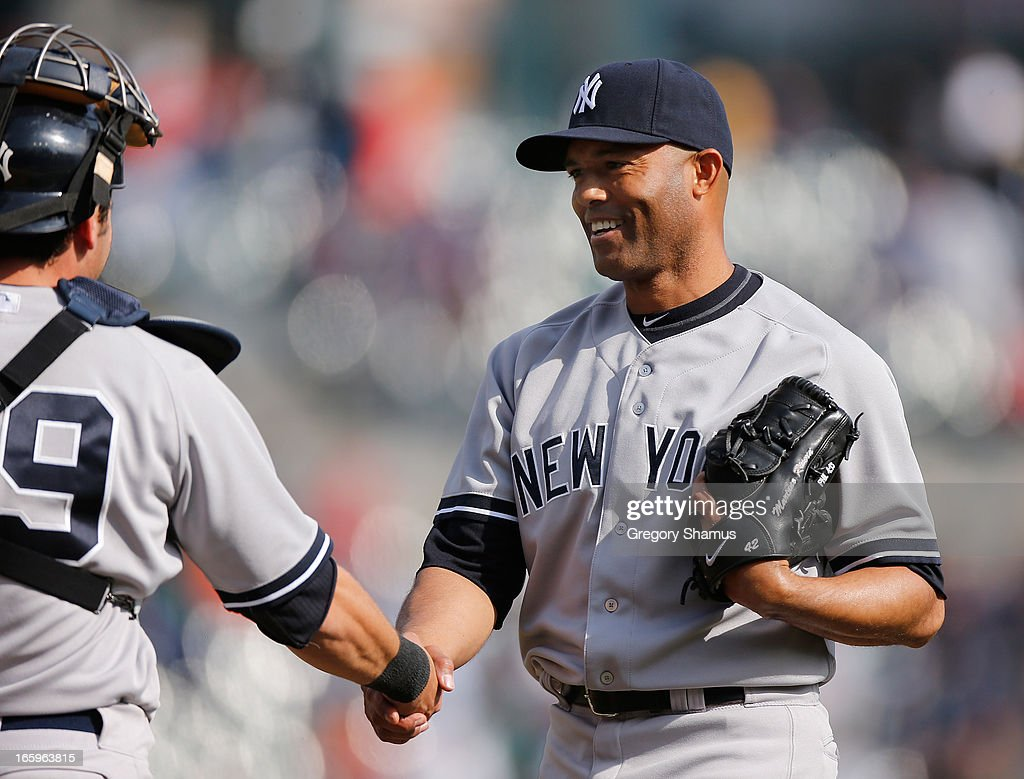 Mariano Rivera #42 of the New York Yankees celebrates a 7-0 win over the Detroit Tigers with Francisco Cervelli #29 at Comerica Park on April 7, 2013 in Detroit, Michigan.