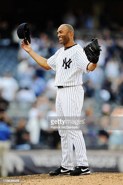 Mariano Rivera of the New York Yankees celebrates after becoming the alltime leader in saves after defeating the Minnesota Twins at Yankee Stadium on...