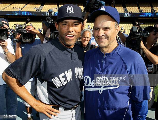 Mariano Rivera of the New York Yankees greets manager Joe Torre of the Los Angeles Dodgers before their game on June 25 2010 at Dodger Stadium in Los...