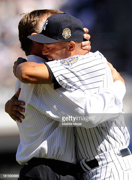 Mariano Rivera of the New York Yankees hugs former teammate John Wetteland during the Mariano Rivera Day pregame ceremony on September 22 2013 at...