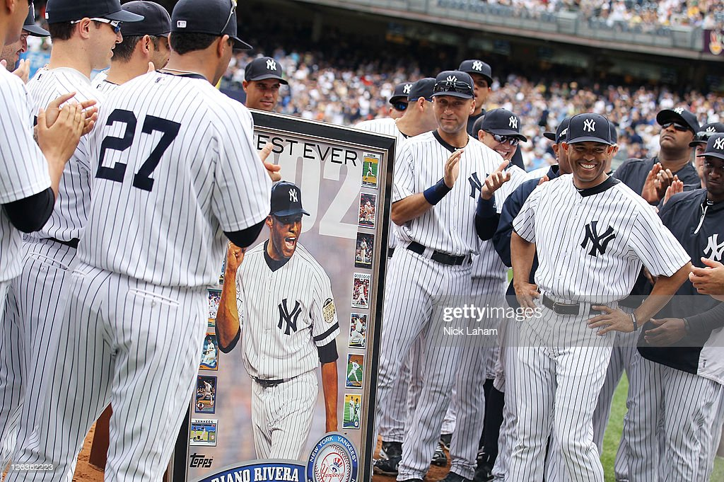 Mariano Rivera #42 of the New York Yankees is presented with a framed picture during a ceremony to celebrate his record 602nd career save prior to the game against the Boston Red Sox on September 25, 2011 at Yankee Stadium in the Bronx borough of New York City.