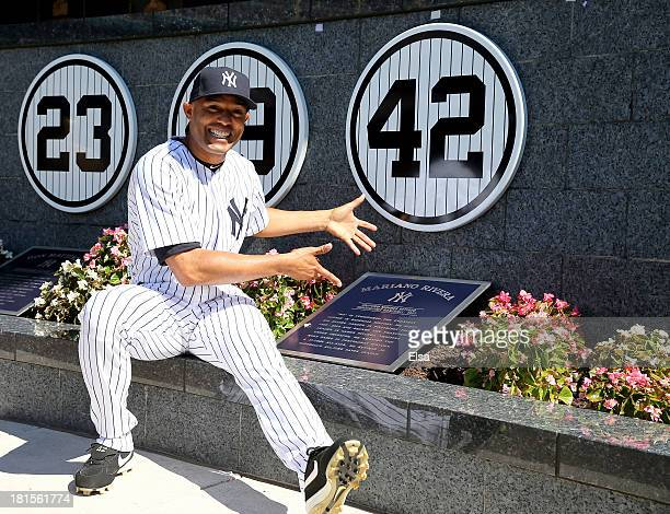 Mariano Rivera of the New York Yankees poses next to his retired number in Monument Park before the game against the San Francisco Giants during...