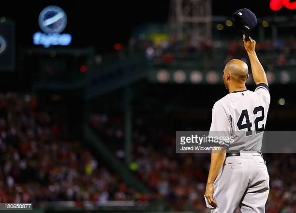 Mariano Rivera of the New York Yankees tips his hat to the crowd after being honored prior to the game against the Boston Red Sox on September 15...