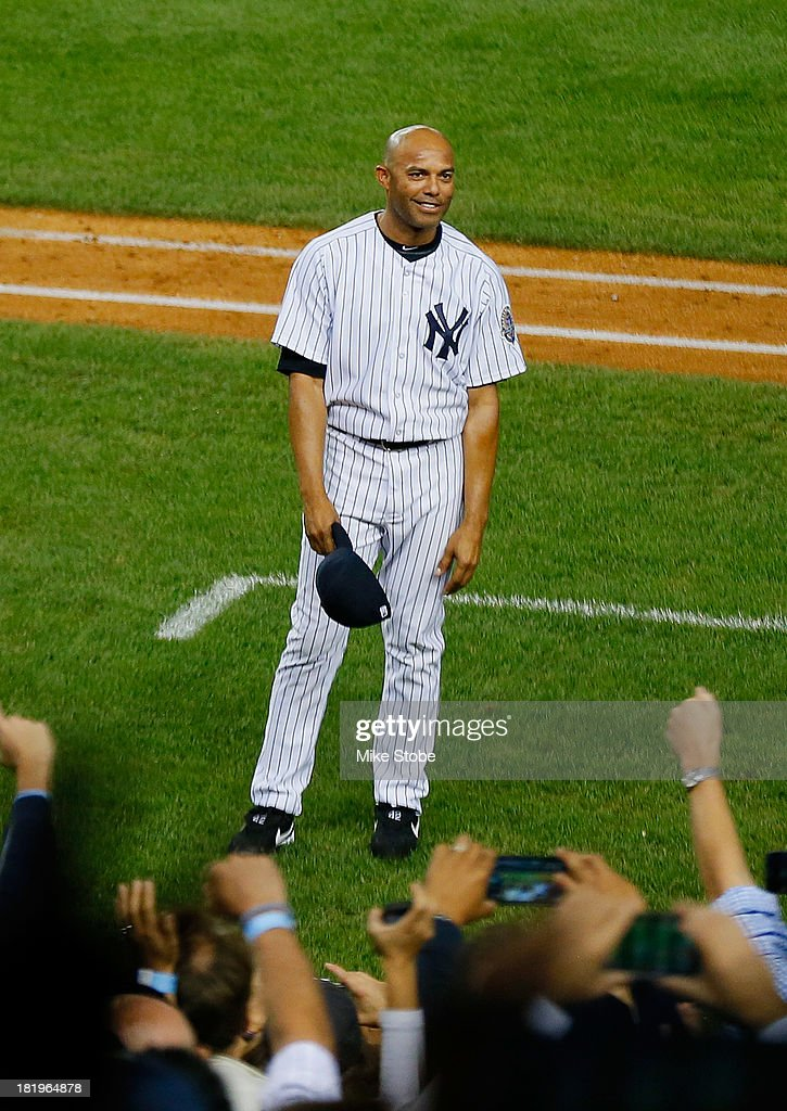 Mariano Rivera #42 of the New York Yankees waves to the crowd after leaving the game against the Tampa Bay Rays in the ninth inning at Yankee Stadium on September 26, 2013 in the Bronx borough of New York City.