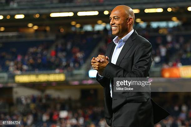 Mariano Rivera wals to greet David Ortiz of the Boston Red Sox as he is honored before a game against the New York Yankees at Yankee Stadium on...