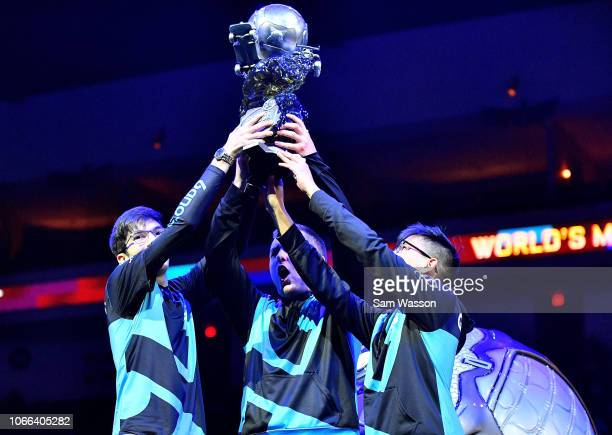 Mariano 'SquishyMuffinz' Arruda Kyle 'Torment' Storer and Jesus 'Gimmick' Parra of team Cloud9 hold up the championship trophy after winning the...