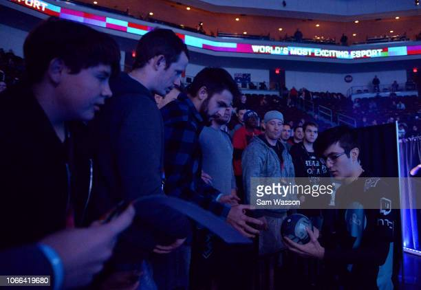 Mariano 'SquishyMuffinz' Arruda of team Cloud9 signs an autograph before the grand finals match of the Rocket League Championship Series World...