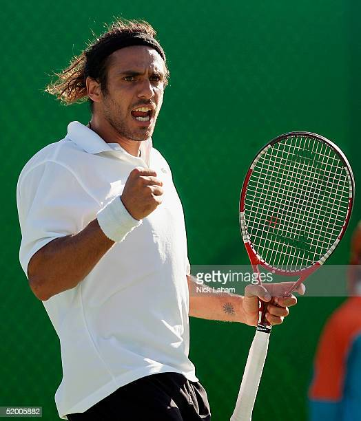 Mariano Zabaleta of Argentina celebrates a point against Marc Kimmich of Australia during day two of the Australian Open Grand Slam at Melbourne Park...