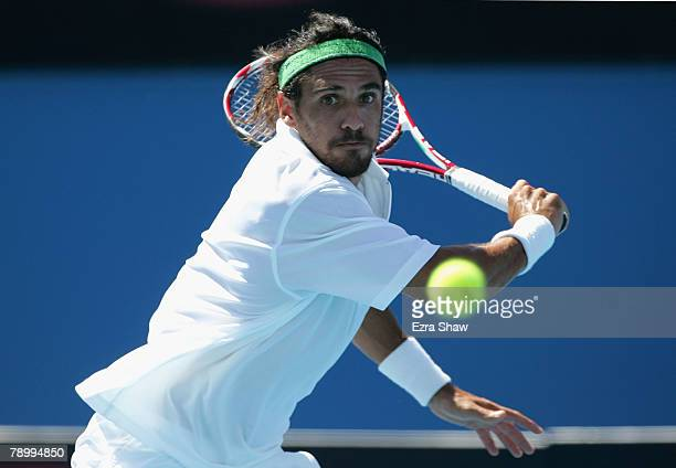 Mariano Zabaleta of Argentina plays a backhand during his first round match between Peter Luczak of Australia on day two of the Australian Open 2008...