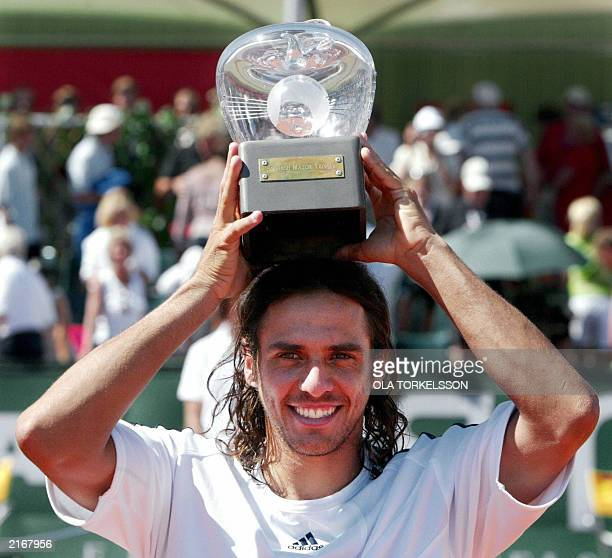 Mariano Zabaleta of Argentina poses with the trophy after winning the final of the Swedish Open tennis tournament in Baastad Sweden 13 July 2003...