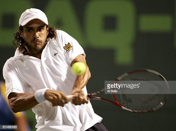 Mariano Zabaleta of Argentina returns to Roger Federer of Switzerland during the NASDAQ100 Open at the Crandon Park Tennis Center on March 28 2005 in...