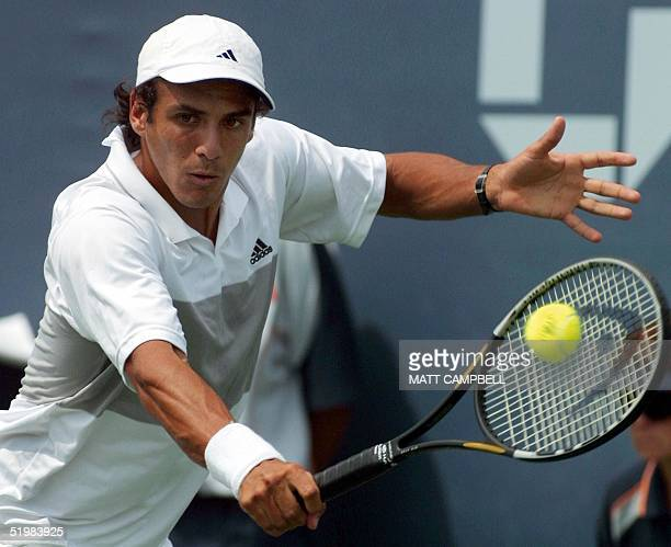 Mariano Zabaleta of Argentina returns to Sebastian Grosjean of France during their first round match at the 2001 US Open at Flushing Meadows New York...