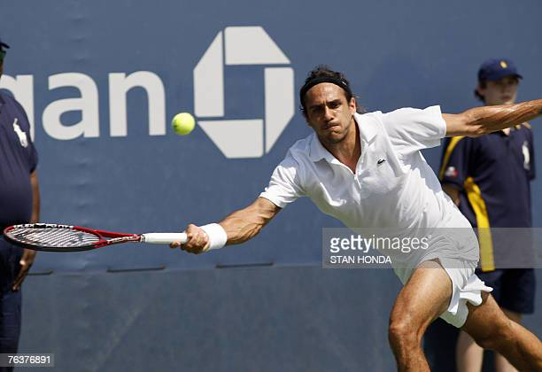 Mariano Zabaleta of Argentina stretches to return a shot to Philipp Kohlschreiber of Germany during the US Open Tennis Championship 29 August 2007 at...