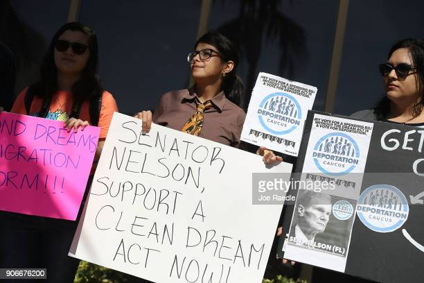 Mariantonieta Chavez Maria Angelica Ramirez and Frida Ulloa stand outside the office of Sen Bill Nelson on January 18 2018 in Coral Gables Florida...