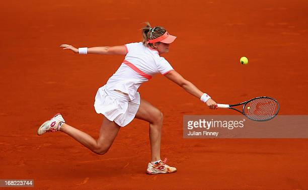 MariaTeresa TorroFlor of Spain in action against Marion Bartoli of France during day four of the Mutua Madrid Open tennis tournament at the Caja...