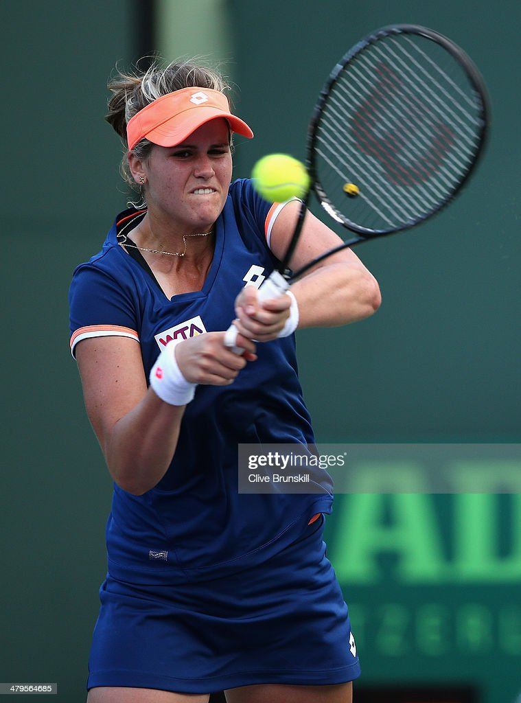 Maria-Teresa Torro-Flor of Spain plays a backhand against Andrea Petkovic of Germany during their first round match during day 3 at the Sony Open at Crandon Park Tennis Center on March 19, 2014 in Key Biscayne, Florida.
