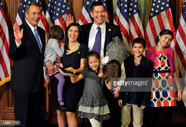 MariaVictoria Duffy tires to get down from the arms of her father Rep Sean Duffy during the family's photograph with Speaker of the House John...
