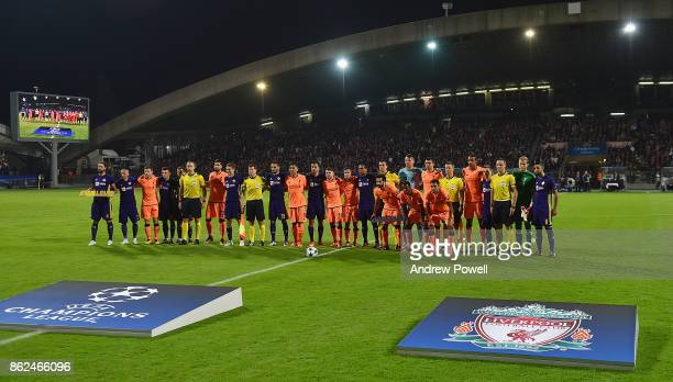 NK Maribor and Liverpool line up together before the UEFA Champions League group E match between NK Maribor and Liverpool FC at Stadion Ljudski vrt...