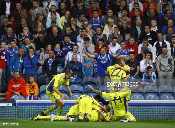Maribor players celebrate their goal during the UEFA Europa League play off match between Rangers and Maribor at Ibrox Stadium on August 25 2011 in...