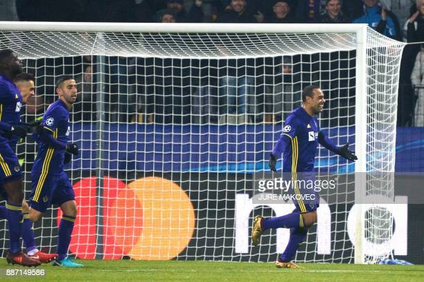 Maribor's Brazilian forward Marcos Tavares celebrates after scoring a goal during the UEFA Champions League Group E football match between NK Maribor...