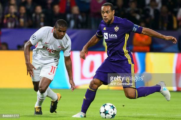 NK Maribor's Brazilian forward Marcos Tavares vies for the ball with Spartak Moscow's Brazilian midfielder Fernando during the UEFA Champions League...
