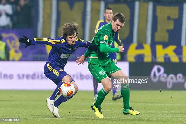 Maribors Damjan Bohar vies with James McArthur of Wigan Athletic during the UEFA Europa League football match between NK Maribor and Wigan Athletic...