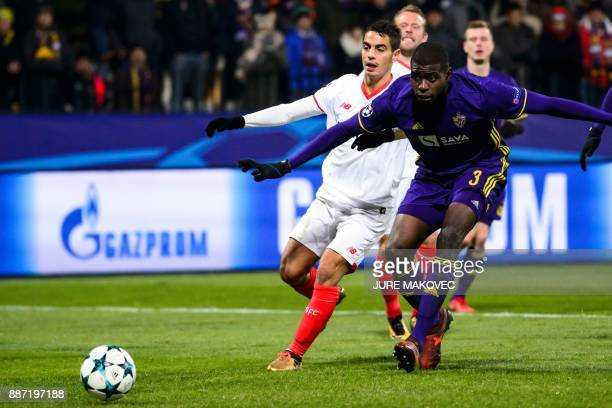 Maribor's French defender JeanClaude Billong vies with French forward Wissam Ben Yedder during the UEFA Champions League Group E football match...