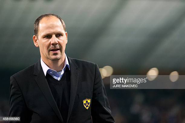 NK Maribor's head coach Ante Simundza arrives for the second half during the UEFA Champions League Group G football match between NK Maribor and...