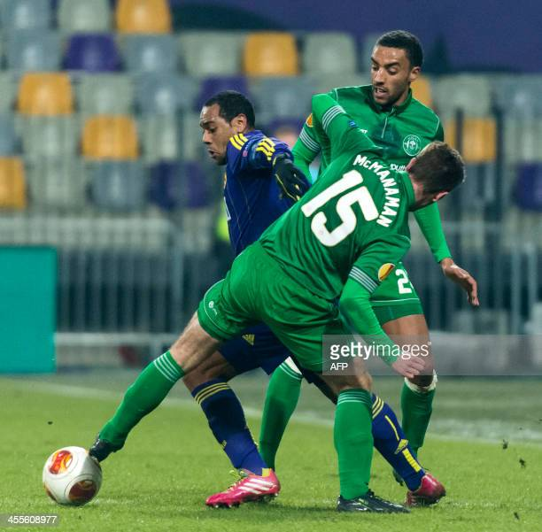 Maribor's Marcos Tavares vies with James Perch of Wigan Athletic during the UEFA Europa League football match between NK Maribor and Wigan Athletic...