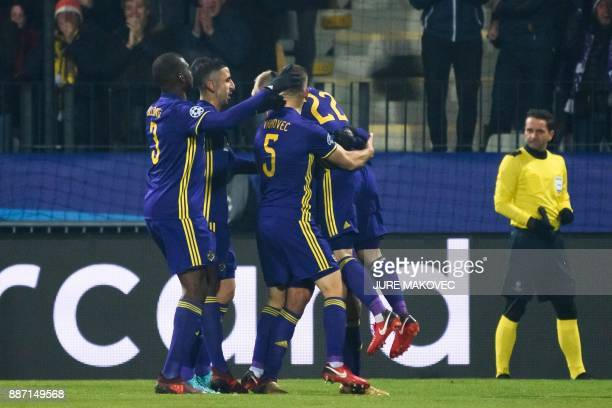 Maribor's players celebrate after scoring a goal during the UEFA Champions League Group E football match between NK Maribor and Sevilla FC at the...