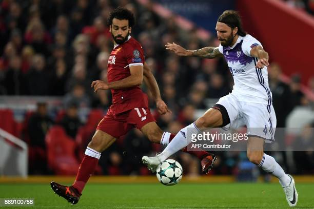 Maribor's Slovenian defender Marko Suler vies with Liverpool's Egyptian midfielder Mohamed Salah during the UEFA Champions League Group E football...