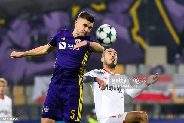 Maribor's Slovenian midfielder Blaz Vrhovec heads the ball with Argentinian midfielder Guido Pizarro during the UEFA Champions League Group E...