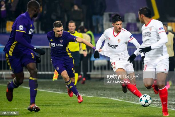 Maribor's Slovenian midfielder Blaz Vrhovec vies with Sevilla's Argentinian midfielder Joaquin Correa during the UEFA Champions League Group E...