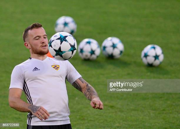 NK Maribor's Slovenian midfielder Dino Hotic controls the ball during a training session at the Sanchez Pizjuan stadium in Sevilla on September 25...