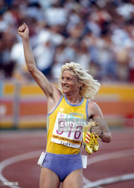 Maricica Puica of Romania celebrates after finishing in first place to win the gold medal in the final of the Woman's 3000 metres event at the 1984...