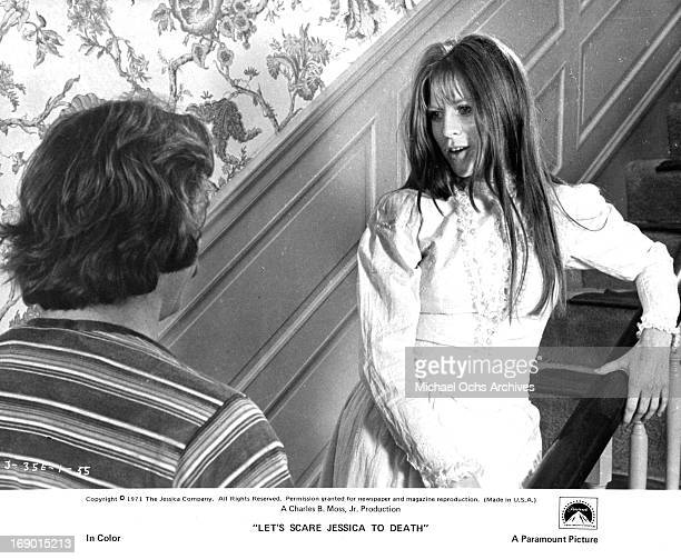 Mariclare Costello stands on the staircase as she talks with Kevin O'Connor in a scene from the film 'Let's Scare Jessica To Death' 1971