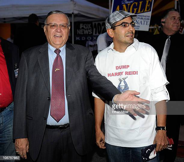 Maricopa County Arizona Sheriff Joe Arpaio poses for a photo with Victor Roque of Nevada as Arpaio arrives to speak at a Tea Party Express rally at...