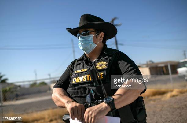 Maricopa County constable Darlene Martinez arrives to a home to post an eviction order on October 1, 2020 in Phoenix, Arizona. Thousands of...