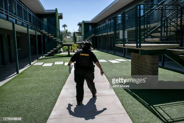 Maricopa County constable Darlene Martinez arrives to an apartment complex to post an eviction order on October 1, 2020 in Phoenix, Arizona....